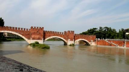 Brick bridge on Adige River in Verona. Italy