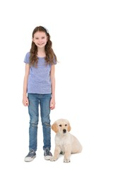 Smiling little girl standing next to dog