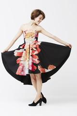 Fashionable woman posing in dress