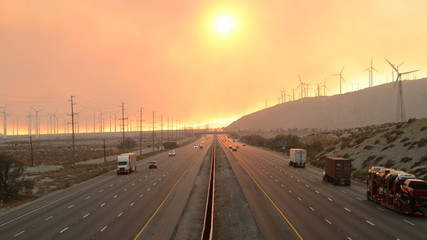 Traffic on Highway with Fire Smoke Sunset