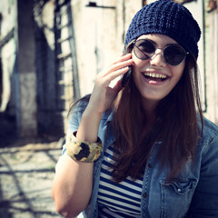 A portrait of a smiling beautiful woman calling with her phone,