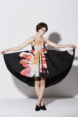 Fashionable woman in glamorous dress