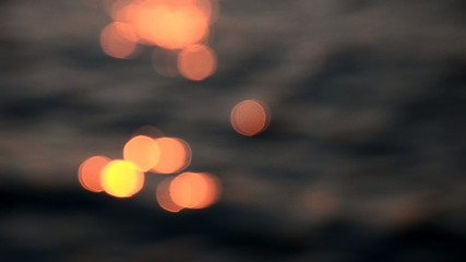 Nice sunset light bokeh on sea wave, Blurred light background