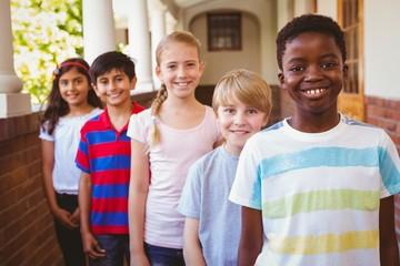 Smiling little school kids in school corridor