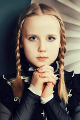Fashion girl teen with braids and makeup