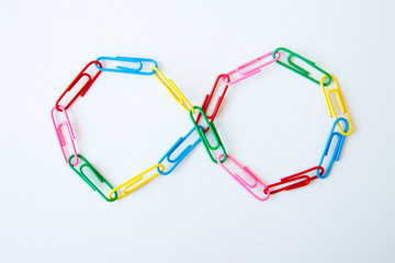 variety of colorful paper clips on white background