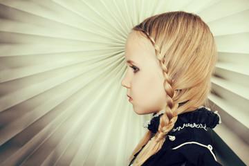 Girl with braids of blond hair, fine art portrait