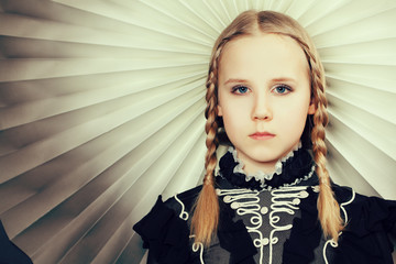 Young girl with braids, fashion portrait