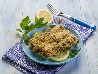 breaded anchovies with lemon and parsley