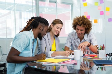 Creative business people working at desk