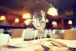 Leinwanddruck Bild - Served dinner table in a restaurant. Restaurant interior