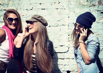 Girls having fun together outdoors and calling smart phone, life