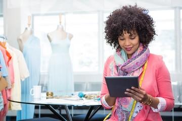 Female fashion designer using digital tablet