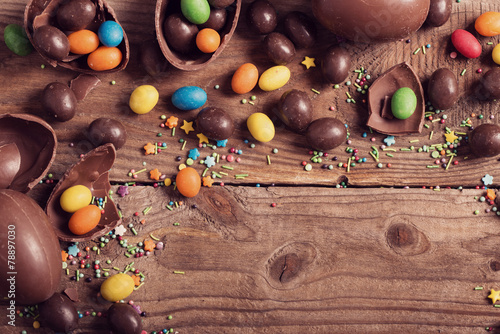 Fotobehang Dessert Chocolate Easter Eggs Over Wooden Background