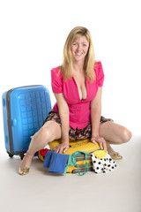 Woman trying to close her holiday suitcase