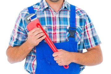 Cropped image of repairman holding monkey wrench