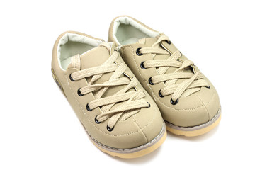 a pair of children's shoes on a white background