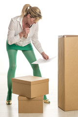 Woman working in office checking deliveries