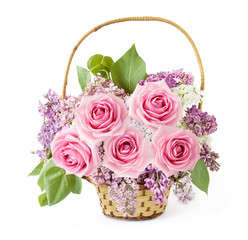 Basket with lilac and roses flowers isolated