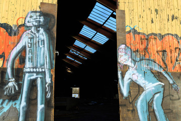 Graffiti on doors of an old, abandoned warehouse, in Groningen.