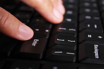 Close-up of hands on the keyboard of laptop or computer