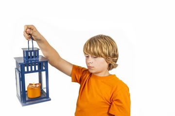 cute boy holding a hand lantern