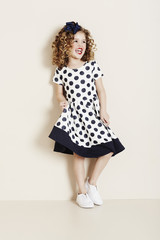 Girl laughing in spotty dress