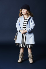Fashionable girl in blue coat