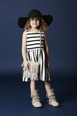Fashionable girl in striped dress