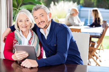 Portrait Of Grandmother And Grandson Using Digital Tablet