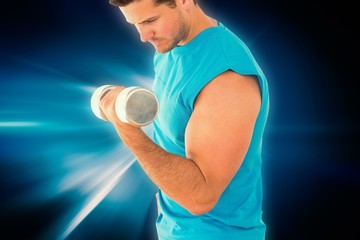 Composite image of sporty young man with dumbbell in gym