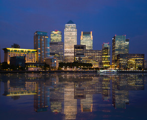 Canary Wharf night view with reflection in Thames river