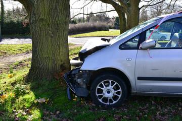 A head on car crash into a tree in Horley, Surrey in winter.