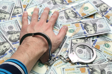 Hand in handcuffs