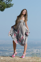 Outdoor fashion shot of young woman in dress