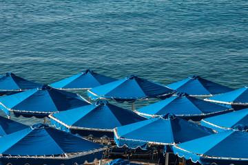 blue umbrella on the beach near the sea