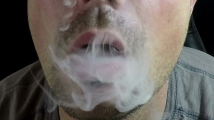 Man Exhaling smoke from a vaporizer 120 FPS Two
