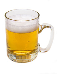 Mug of beer with froth over white background