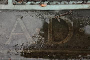 A.D. Anno Domini. Inscription on a bronze gravestone.