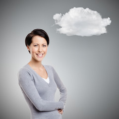 Smiley young woman with cloud, on grey background