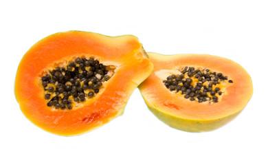 Fresh papaya cut in half on white background