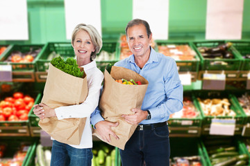 Mature Couple Holding  Grocery Bags