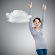 Glad pretty woman puts her hands up, grey background with cloud