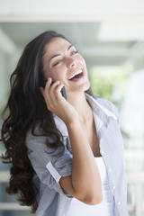 Happy Latin Woman on the Phone
