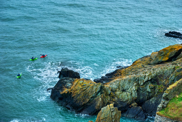 Three Men Kayaking