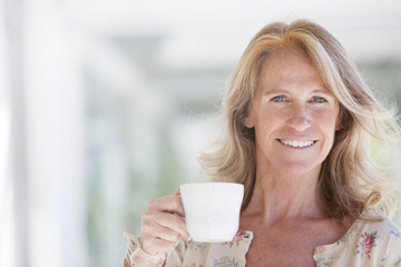 Happy Mature Woman Drinking Tea