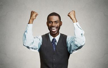 Successful businessman celebrates victory grey background