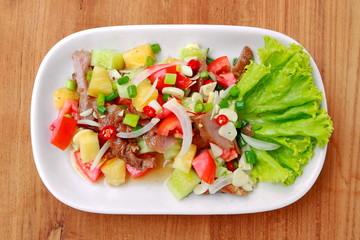 Thai-style spicy grilled pork salad