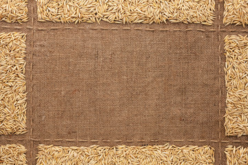 Beautiful frame with oats on sackcloth
