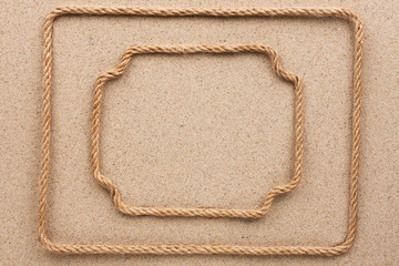 Two frame made of rope lying on the sand